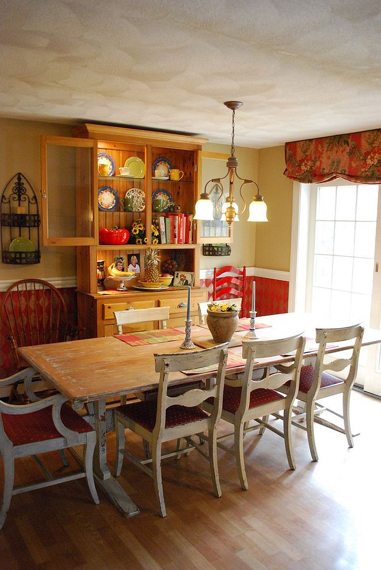 Gorgeous hutch creates a cool and colorful backdrop in this farmhouse style dining space [From: Michelle Jamieson Interiors / New England Style]