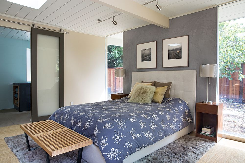 Gray accent wall for the spacious modern bedroom