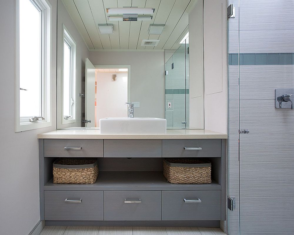 Gray bathroom vanity with ample storage