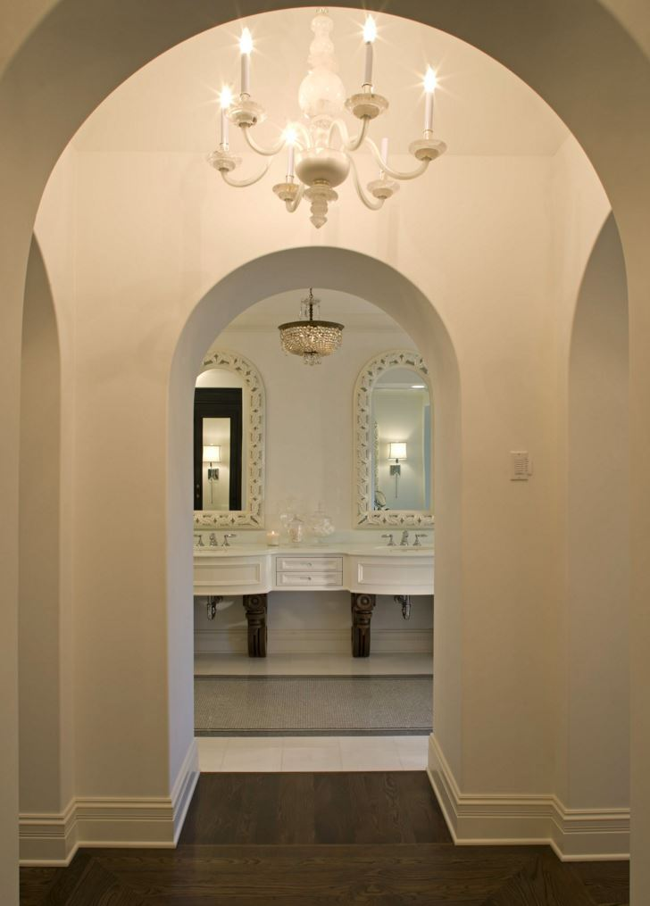 Hallway view to an elegant eclectic bathroom