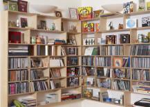 Hanging corner bookcase creates handy storage 217x155 10 Rooms with Corner Shelving