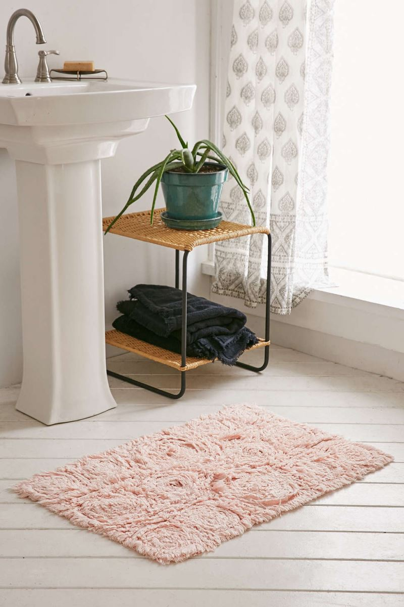 Hint of pink in a white bathroom