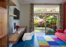 Home office with colorful rug and a live-edge table