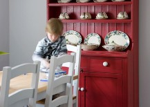 Hutch in bright red adds color and class to the transitional kitchen