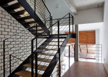 Industrial staircase connects the various levels of the home