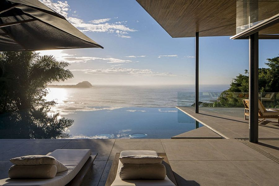 Infinity pool and deck zone connected with the veranda