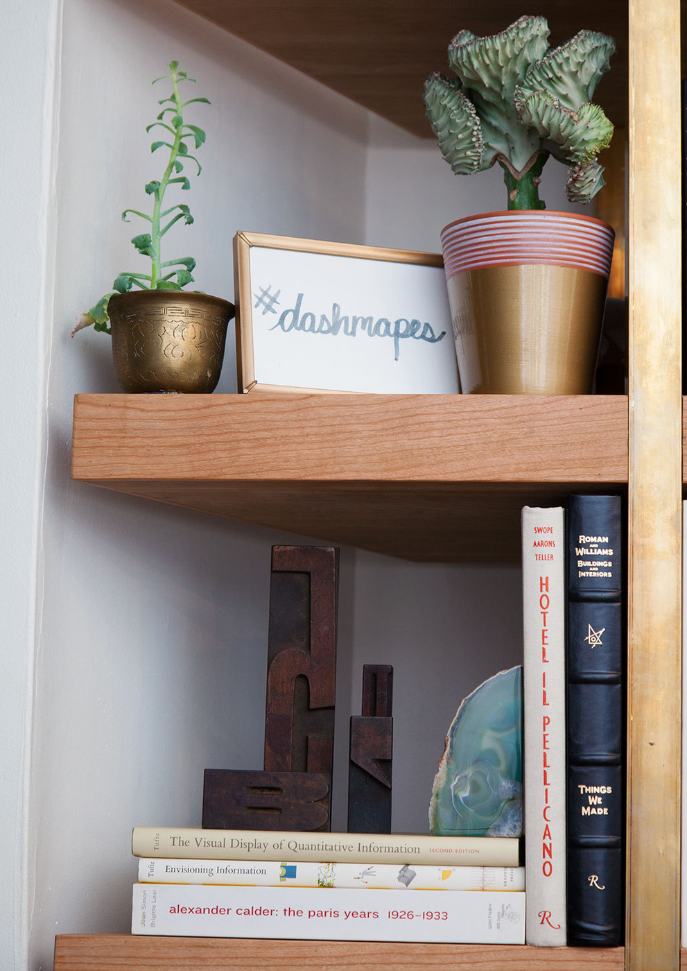 Interesting objects on a styled bookshelf