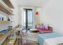 Kids'  bedroom with colorful lighting and bedding