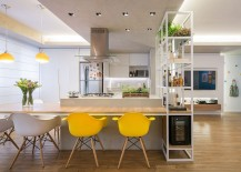 Kitchen and dining space rolled into one inside the clever apartment in Brasilia