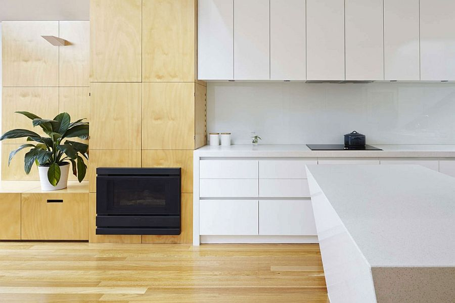 Kitchen cabinetry and living room shelves delineate one space from the next