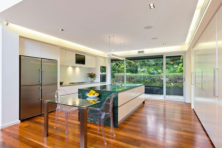 Kitchen with breakfast zone that features acrylic chairs