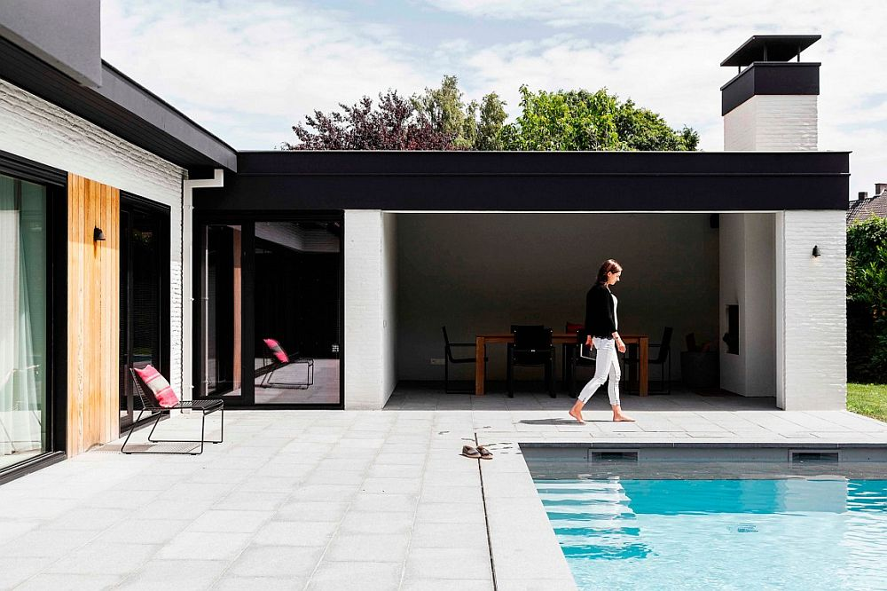 L-shaped structure of the home warps itself around the lovely pool