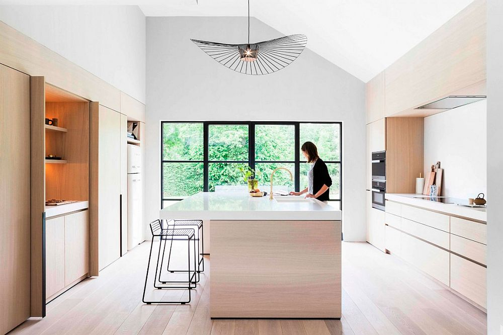 Large Vertigo lamp shines above the smart, modern kitchen island