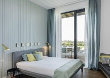 Large glass doors connect the bedroom with the deck space outside