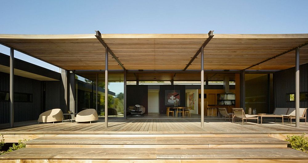 Large, shaded wooden deck extends the living area outdoors