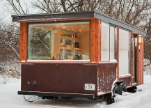Large windows of the tiny home ensure that you are always connecetd with the landscape outside