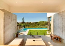 Lavish Spanish home overlooking the backyard, pool area and distant hills