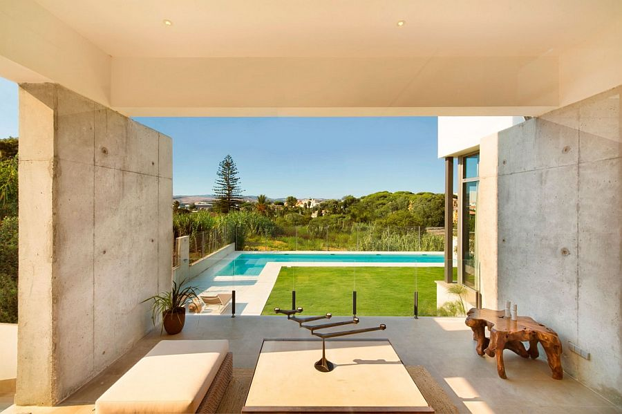 Lavish Spanih home overlooking the backyard, pool area and distant hills