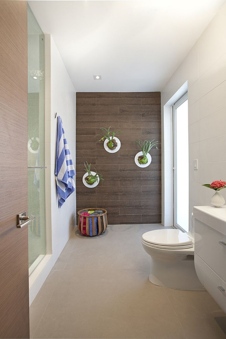 Light-filled modern bathroom is perfect for indoor plants [Design: DKOR Interiors]