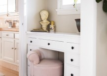 Light pink stool in a traditional bathroom