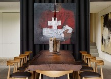 Live-edge dining table plays into the raw, industrial theme of the living room