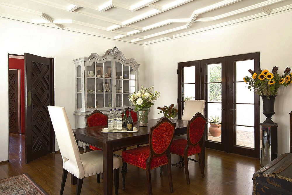 Lovely hutch adds classic charm to the traditional dining space with colorful red chairs [Design: TNT Simmonds]