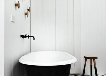 Lovely use of mismatched black and white floor tiles in the bathroom