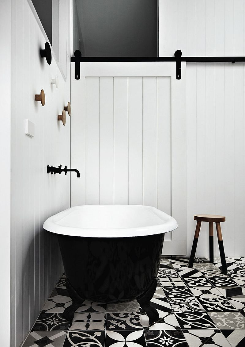 Lovely use of mismatched black and white floor tiles in the bathroom [Design: Whiting Architects]
