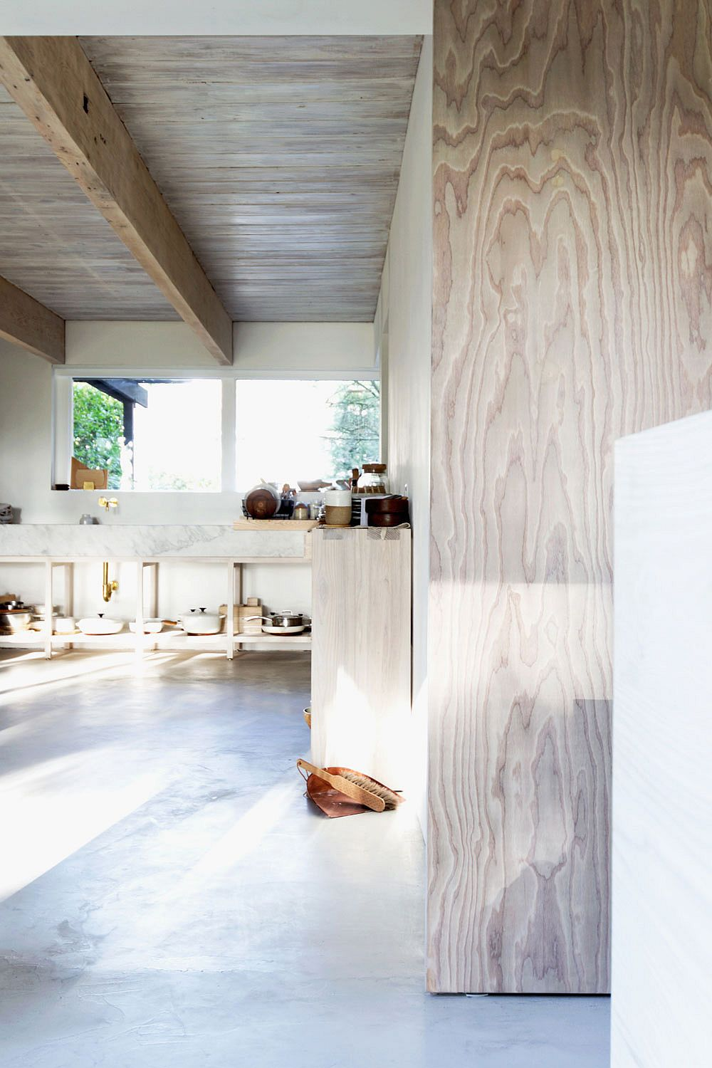 Marble kitchen workstation adds contrast to the interior