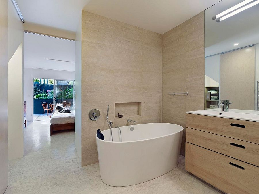 Master bedroom and bathroom nestle on the private lower level of the house