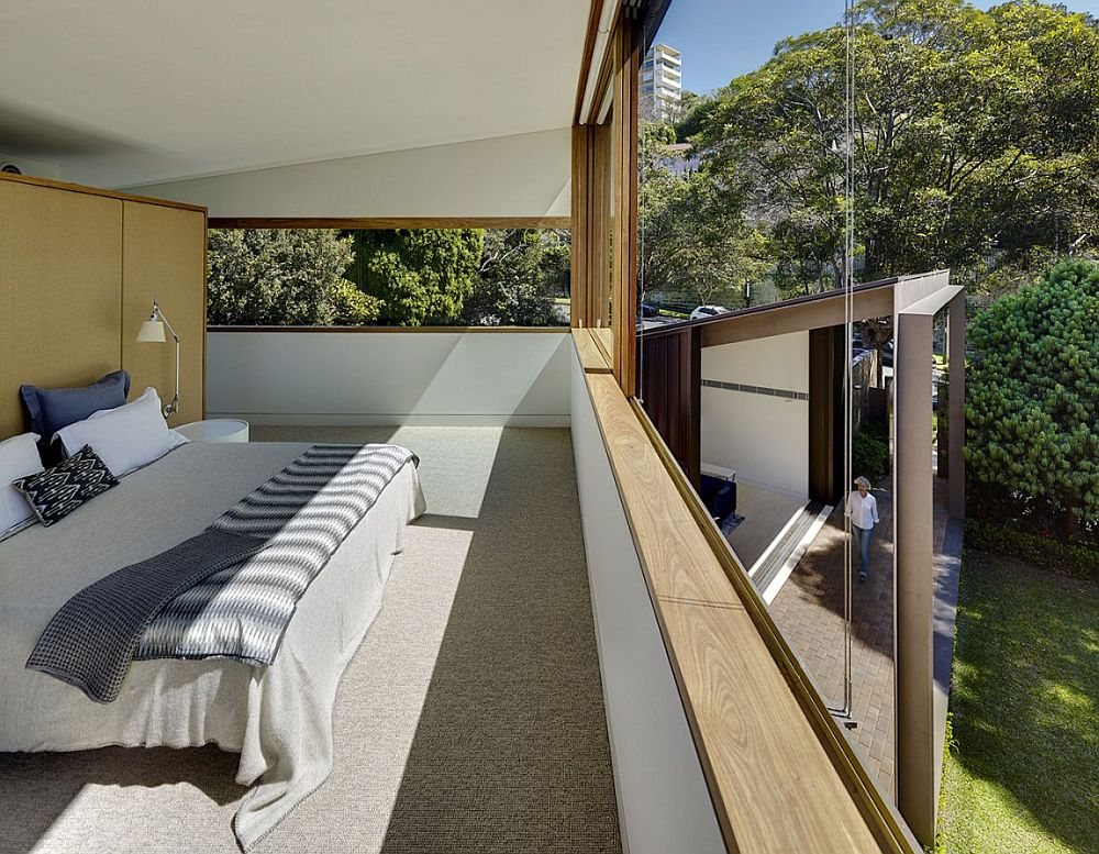 Master bedroom on the second level with retractable windows that offer unabated garden views