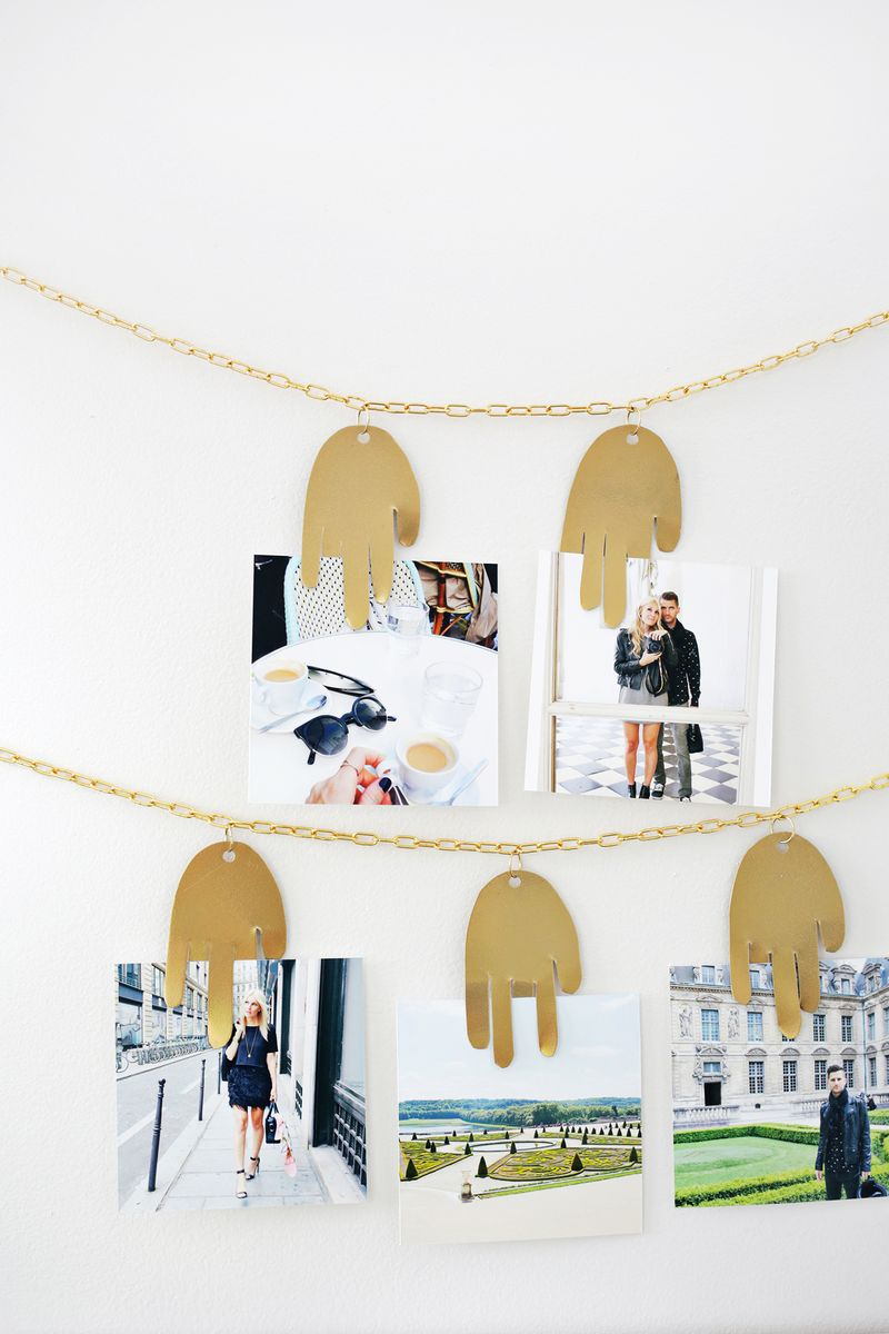 Metal hand photo hanger from A Beautiful Mess