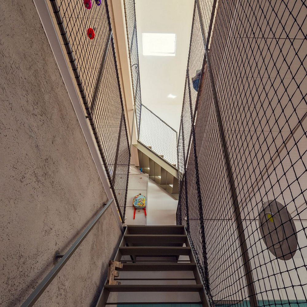 Metallic mesh for the staircase offers a cost effective safety solution for family with kids