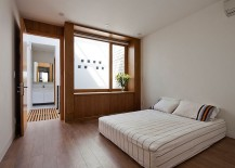 Minimal-modern-bedroom-with-warmth-of-wood-217x155