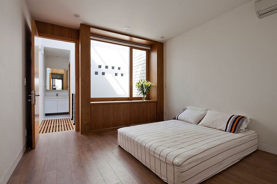 Minimal modern bedroom with warmth of wood