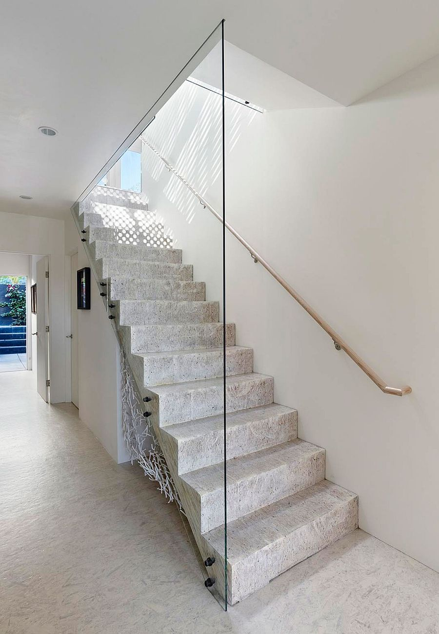 Minimal modern staircase connects teh various levels of revamped San Francisco home