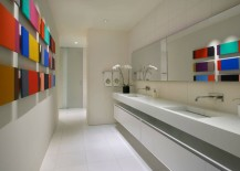 Modern artwork decorates a bathroom wall 217x155 Bathroom Color Schemes to Explore This Spring