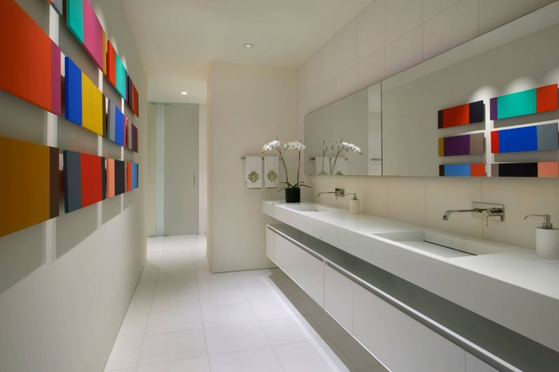 Modern artwork decorates a bathroom wall