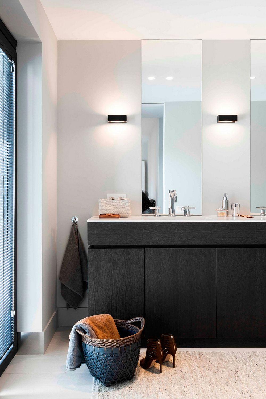 Modern bathroom in white with a dark vanity