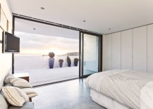 Modern bedroom with a balcony view of plants