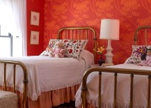 Modern farmhouse style bedroom with red and orange wallpaper and striped rug