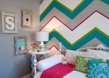Multi-colored chevron stripes make a stunning accent wall in the kids' bedroom