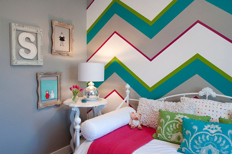 Multi-colored chevron stripes make a stunning accent wall in the kids' bedroom [Design: Judith Balis Interiors / Allison Corona Photography]