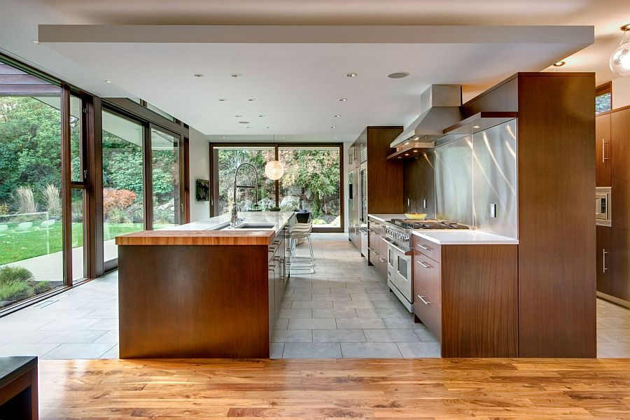 OPen kitchen area with large workstation and a central island