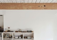 Open kitchen cabinetry with collection of studio pottery