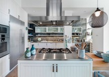 Open kitchen in white and gray with stainless steel and wooden worktops