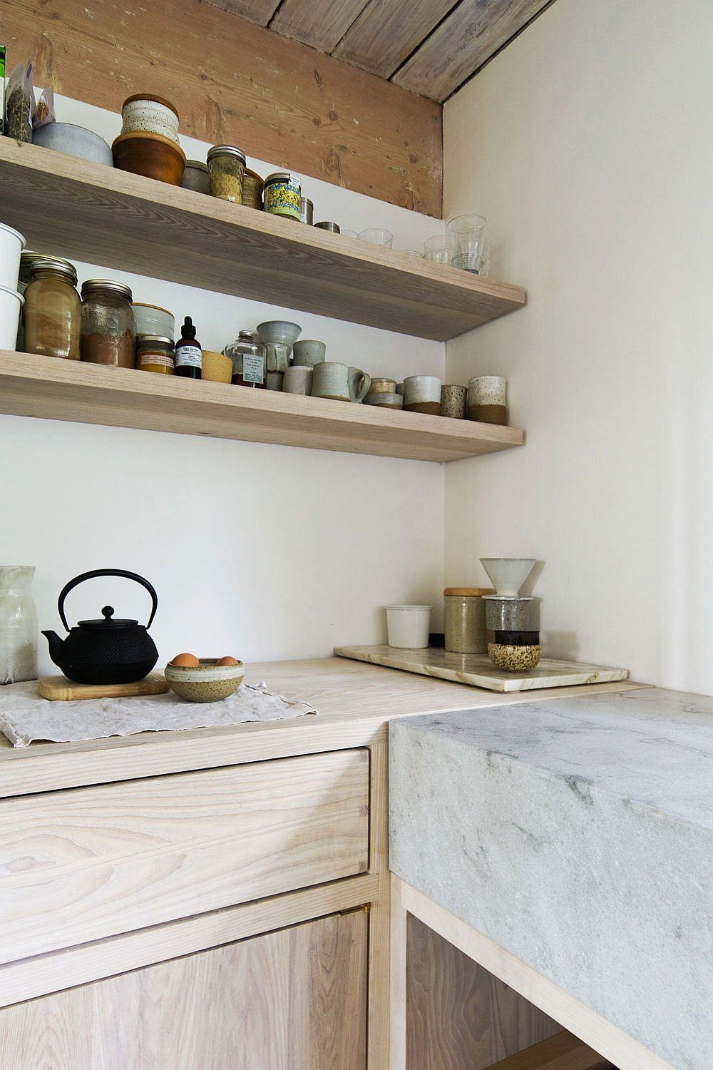 Open kitchen shelves make complete use of vertical space on offer