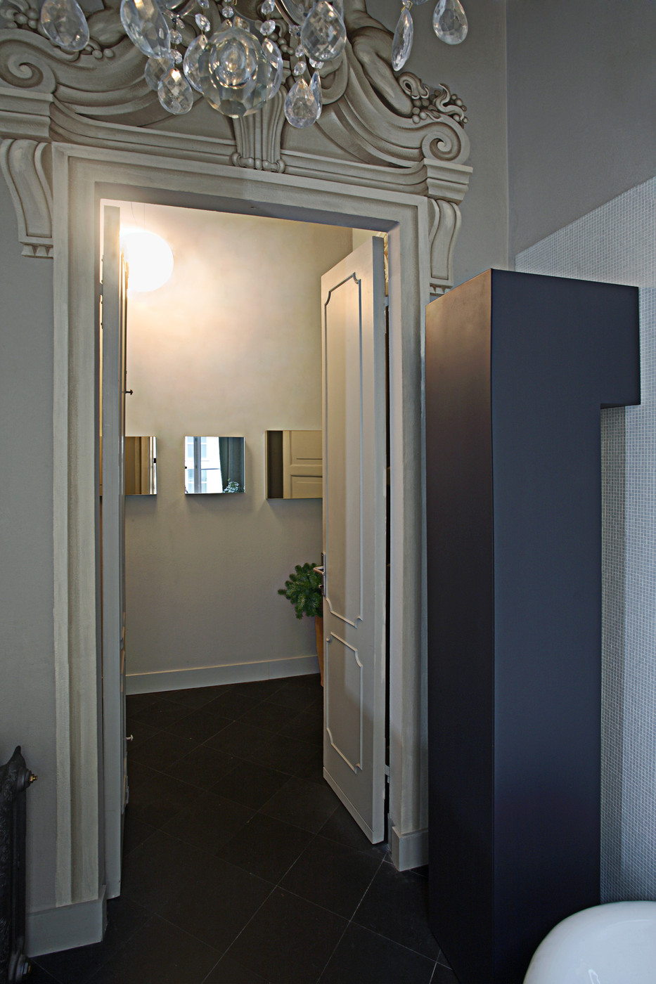 Ornate doorway with a mirrored view