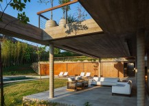Outdoor-sitting-zone-and-poolside-deck-of-the-FT-Residence-217x155