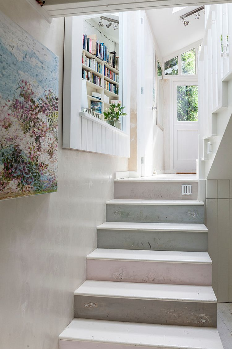 Plaster finish and shelf for the staircase wall create a cozy and fun ambiance
